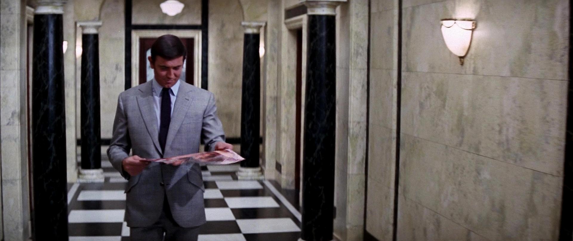 James Bond (George Lazenby) walking away with the centrefold photo © 1969 Metro-Goldwyn-Mayer Studios Inc., Danjaq, LLC and United Artists