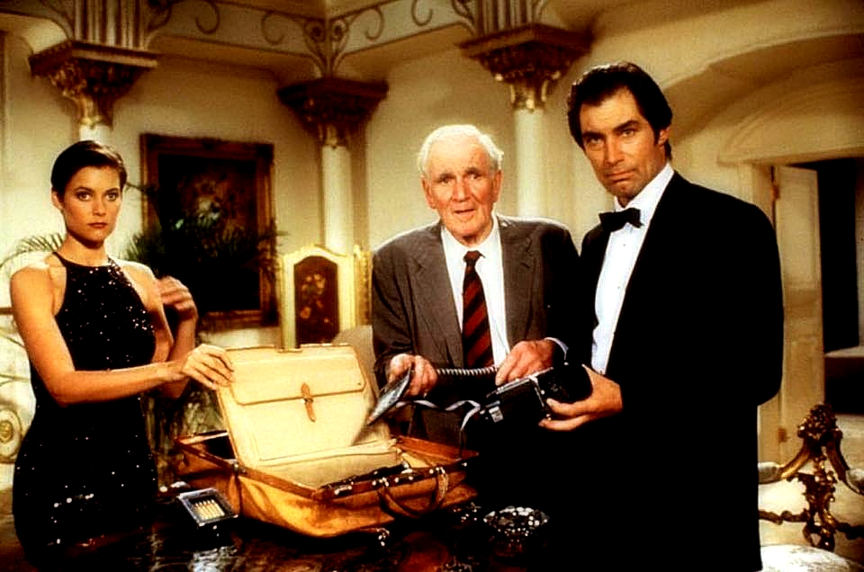 """Carey Lowell (left), Desmond Llewellyn (center) and Timothy Dalton in a still from """"Licence To Kill"""" (1989) - Photo: EON Productions, Danjaq LLC."""