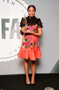 Naomie Harris posing with her Variety Award